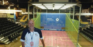 Eric Zillmer, Drexel's Director of Athletics, stands in front of the newly-constructed glass squash court that will be used during the 2011 US. Open Squash Championships. The court is found in the main arena in the DAC.