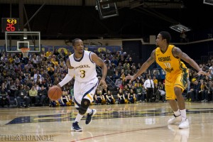 Drexel junior guard Chris Fouch dribbles the ball around the three-point line, while being defended by George Mason redshirt sophomore guard Sherrod Wright during the Dragons 60-53 win over the Patriots at the DAC Jan. 12. Fouch scored six points in 13 minutes.