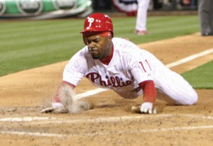 Philadelphia Phillies' Jimmy Rollins scores on a base hit by Hunter Pence during 3rd-inning action against the Miami Marlins at Citizens Bank Park in Philadelphia, Pa., April 11.