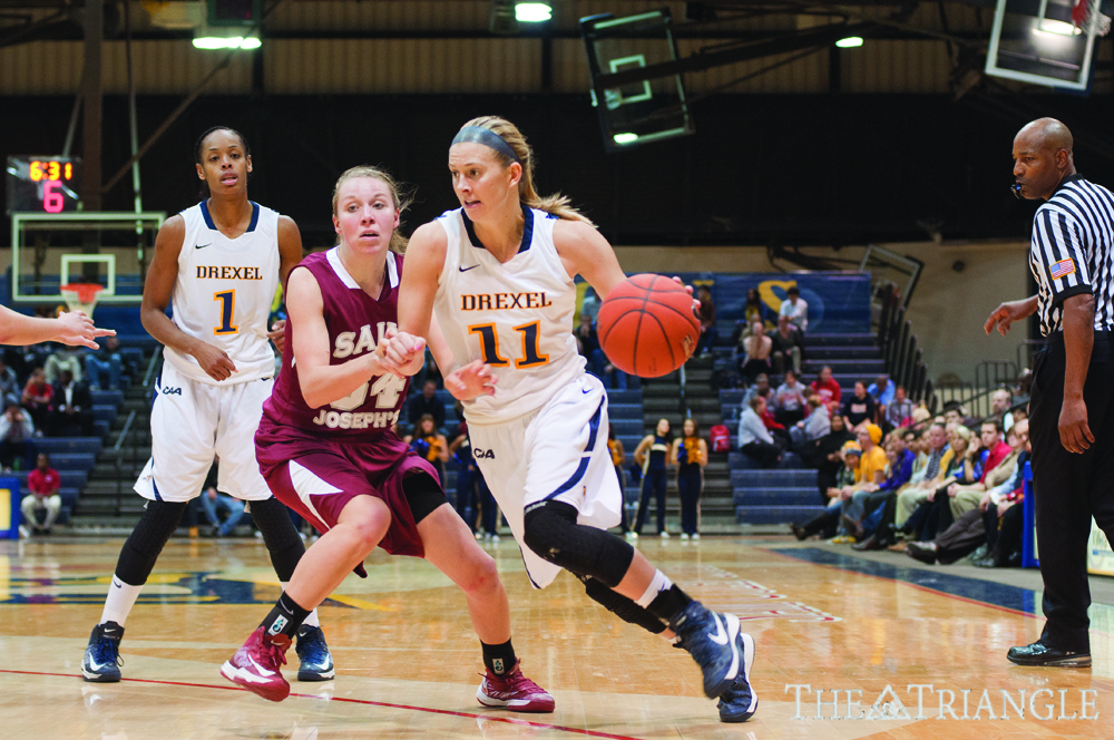 Credit: Ken Chaney | Senior point guard Hollie Mershon drives to her left during Drexel's 47-45 loss to Saint Joseph's University Nov. 14. The Dragons lost their home opener on a three-pointer by Hawks junior guard Erin Shields as time expired.
