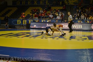 Freshman Jacob Goodwin, who competes in the 125-lb. weight class, handles his opponent in a wrestling match at the DAC.