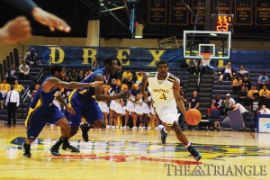 Senior point guard Frantz Massenat drives past a double-team in the Dragons' 63-54 victory against Hofstra University Feb. 18 at the DAC. Massenat scored 16 points and four assists against the Pride, shooting 4-9 from the field and 7-8 from the foul line.