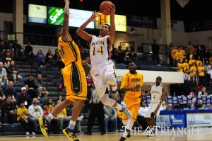 Sophomore guard Damion Lee goes for a layup against george Mason. Lee scored 16 points in the loss.