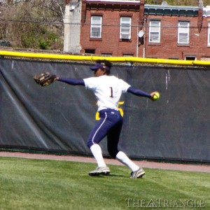 Junior center fielder Comfort Ahonkhai throws in a relay from the warning track in the outfield. Ahonkhai was the leadoff hitter in both games against Charotte and went 2-6 with one walk, one HBP, one RBI and one run.