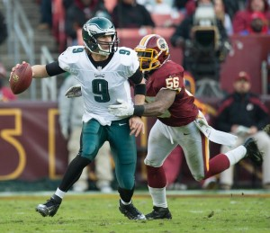 Philadelphia Eagles quarterback Nick Foles is chased and sacked by Washington Redskins inside linebacker Perry Riley at FedEx Field in Landover, Md., Nov. 18, 2012.