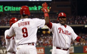The Philadelphia Phillies' Ryan Howard, right, celebrates his first-inning run scored with teammate Domonic Brown against the Washington Nationals Sept. 27, 2012, at Citizens Bank Park in Philadelphia.