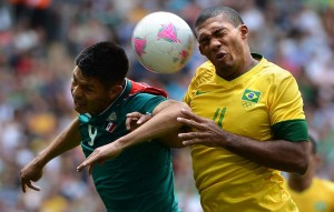 Mexico's Oribe Peralta, left, and Brazil's Juan Jesus battle for the ball in the gold medal match at the Summer Olympics August 11, 2012, at Wembley Stadium in London. Mexico topped Brazil by a score of 2-1, as Peralta scored twice.