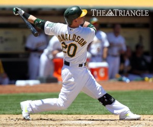 Oakland Athletics third baseman Josh Donaldson follows through after connecting for a three-run homer off Cincinnati Reds pitcher Homer Bailey during the fourth inning at O.co Coliseum in Oakland, Calif., June 26.
