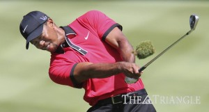 Tiger Woods takes up some turf with his shot on the sixth fairway during the fi nal round of the World Golf Championships Bridgestone Invitational at Firestone Country Club in Akron, Ohio, Aug. 4.