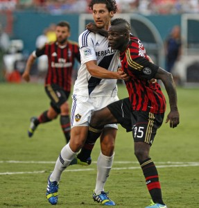 AC Milan's Mario Balotelli, right, tries to break free of Los Angeles Galaxy defender Omar Gonzalez in first-half action in the third-place game of the International Champions Cup at Sun Life Stadium in Miami Aug. 7.