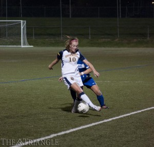 Junior midfielder Megan Hammaker dribbles the ball against a University of Delaware player during Drexel's 1-0 victory over the Blue Hens Oct. 24, 2012, at Vidas Field. Hammaker tallied two goals and one assist last season.