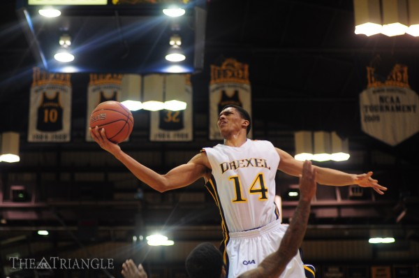 Junior shooting guard Damion Lee skies for a layup during a game at the DAC. (Ken Chaney - The Triangle)