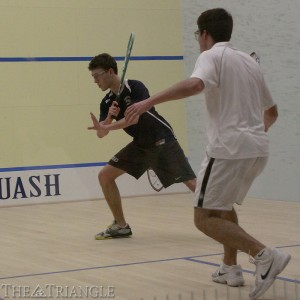 Sophomore Joey Gingold goes for the ball during a squash match against Colgate University Feb. 8. The Dragons triumphed over the Raiders 9-0 at the Kline and Specter Squash Center in their matchup last season.
