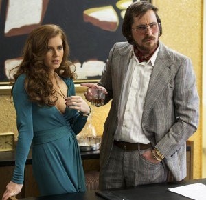 "Photo Courtesy New York Post Amy Adams (left) plays con artist Sydney Prosser in ""American Hustle."" Partnering with Iriving Rosenfeld (played by Christian Bale, pictured at right), the duo work with the FBI to expose a political scandal."