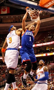 Philadelphia 76ers point guard Michael Carter-Williams dunks over New York Knicks power forward Kenyon Martin at the Wells Fargo Center in Philadelphia Jan. 11.