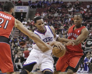 Philadelphia 76ers forward Evan Turner drives between the Toronto Raptors guards Greivis Vasquez and Kyle Lowry during the third quarter at the Wells Fargo Center in Philadelphia Jan. 24. Turner scored 13 points as the Raptors beat the Sixers 104-95.