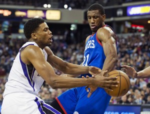 Sacramento Kings forward Rudy Gay has the ball taken away as he drives to the basket against the Philadelphia 76ers' Thaddeus Young at Sleep Train Arena in Sacramento, Calif., Jan. 2.