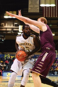 Senior power forward Dartaye Ruffin attempts a shot against a towering College of Charleston defender during Drexel's 56-45 victory Feb. 26.