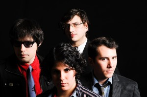 Photo Courtesy Aloud  Aloud is a Boston-based indie rock band who uses two lead singers. The four person group (pictured) includes Henry Beguiristain, Jen de la Osa, Charles Murphy and Frank Hegyi. The band is working on their fourth album.