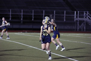 Senior midfielder Amanda Norcini is pictured here against La Salle March 12. The Dragons won April 6 against Towson, 9-8, with Norcini contributing four assists. (Ajon Brodie)
