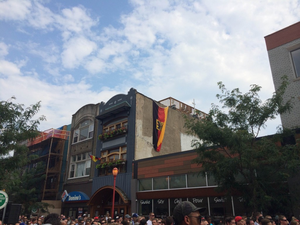 A German flag hangs from the side of Brauhaus Schmitz during the World Cup final Sunday.