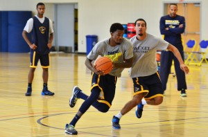 Junior guard Tavon Allen drives against freshman guard Sammy Mojica, Jr., in practice Aug. 19. (Ken Chaney - The Triangle)