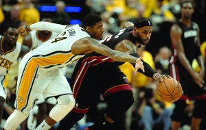 LeBron James, right, chases down the ball in front of the Indiana Pacers' Paul George during the second half on May 28, 2014. (Michael Laughlin - Sun Sentinel/MCT Campus)