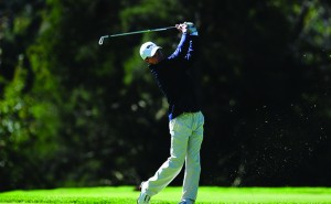 Junior Chris Crawford chips from the fairway during the Patriot Invitational. Crawford played well all weekend before a bad shot on 17 cost him the lead. (Photo courtesy-Drexeldragons.com)