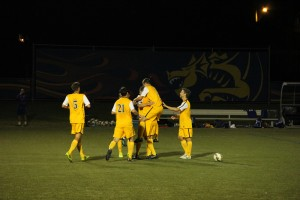 Men's soccer celebrates an early goal against Seton Hall University. (Ajon Brodie - The Triangle)