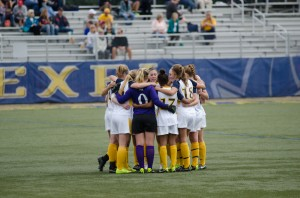 Kelsie Fye leads a team huddle before Oct. 4 game against University of Delaware. (Ken Chaney - The Triangle)