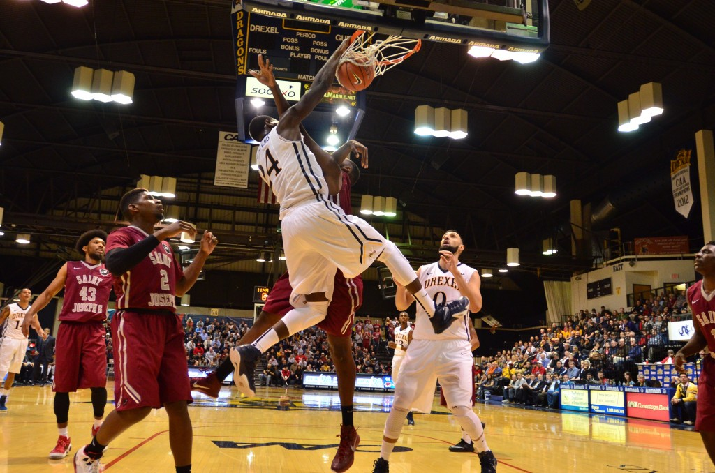 Rodney Williams dunks over a Saint Joseph's University defender during their Nov. 17 contest. (Ken Chaney - The Triangle)