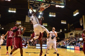 Forward Rodney Williams dunks against St. Joseph's University on Nov. 16. (Ken Chaney - The Triangle)