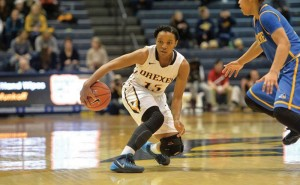 Carrie Alexander makes a move against her defender during the Dragons' Jan. 25 matchup against the University of Delaware. Alexander was one of the leading scorers for the Dragons this week, scoring 10 points against Towson University and 13 points against James Madison University. (Photo Courtesy - Drexeldragons.com)