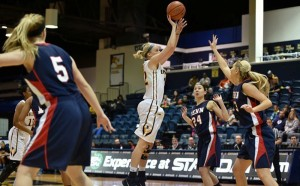 Senior forward Jackie Schluth takes a jumper against University of Pennsylvania. Schluth has emerged as a huge piece to the Dragons' second-place squad, and was honored with the Colonial Athletic Association player of the week award this week. (Photo courtesy - Drexeldragons.com)