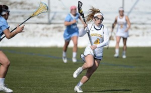 Lacey Aghazarian pushes the ball up the field. Aghazarian, a sophomore midfielder from Maryland, netted 3 goals in the Dragons' 17-10 loss to the University of Maryland, Baltimore County. (Photo Courtesy - Drexeldragons.com)