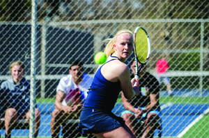 Sophomore Lea Winkler sizes up an incoming ball. Winkler and the women's tennis team won a program-record 15 matches this season. (Ajon Brodie - The Triangle)