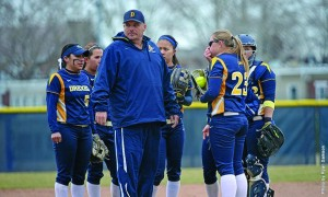 Carl Taylor, pictured third from left, will take over as the full-time head coach of the Drexel University softball team after serving as interim coach since February. (Photo courtesy - Drexel Dragons)