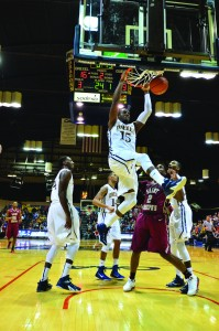 Drexel forward Mohamed Bah, pictured dunking here, will play for the Malian  national team this August in AfroBasket 2015 for a spot in the 2016 Olympics. (Ken Chaney - The Triangle)