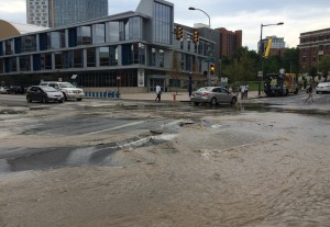The scene at the water main break at the corner of 33rd & Market streets. (Adam Hermann - The Triangle)