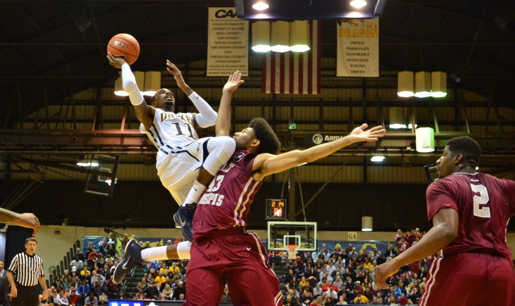 Tavon Allen goes up for a shot against St. Joe's University's DeAndre Bembry Nov. 17. (Ken Chaney - The Triangle)