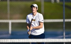 Senior Xabier Saavedra takes his stance in a tennis match earlier this season.  Last weekend at the Princeton Invitational, Saavedra advanced to the singles consolation semifinals and then the Flight 4 semifinals. (Photo Courtesy Drexeldragons.com)