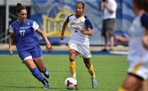 Freshman midfielder Vanessa Kara dribbles by a defender. She leads the team in goals scored and overall points with seven and sixteen, respectively. She also has two assists in eleven starts. (Photo Courtesy - Drexeldragons.com)