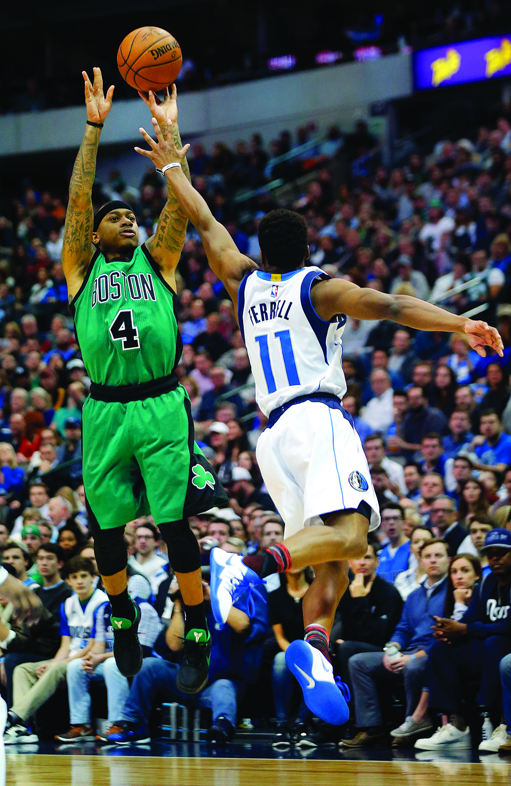 Dallas Mavericks guard Yogi Ferrell (11) tries to get a hand up in the face of Boston Celtics guard Isaiah Thomas (4) during the first half on Monday, Feb. 13, 2017 at the American Airlines Center in Dallas, Texas. (Tom Fox/Dallas Morning News/TNS) NO MAGAZINE SALES MANDATORY CREDIT; NO SALES; INTERNET USE BY TNS CONTRIBUTORS ONLY