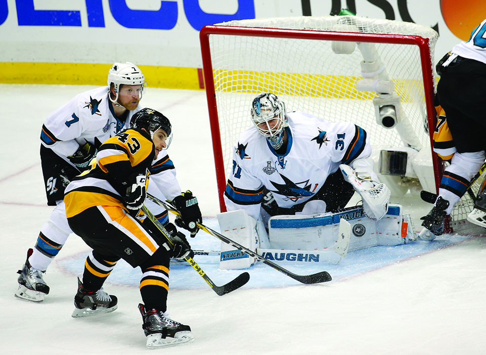 The San Jose Sharks' Paul Martin (7) helps goaltender Martin Jones (31) make a save against the Pittsburgh Penguins' Conor Sheary (43) in the third period of Game 5 of the Stanley Cup Final at Consol Energy Center in Pittsburgh, Pa., on Thursday, June 9, 2016. The Sharks won, 4-2, to cut the Pens' series lead to 3-2. (Josie Lepe/Bay Area News Group/TNS)